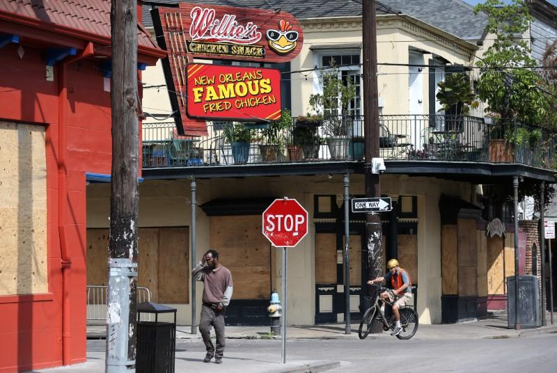 Boarded up businesses are pictured on Frenchmen Street in New Orleans
