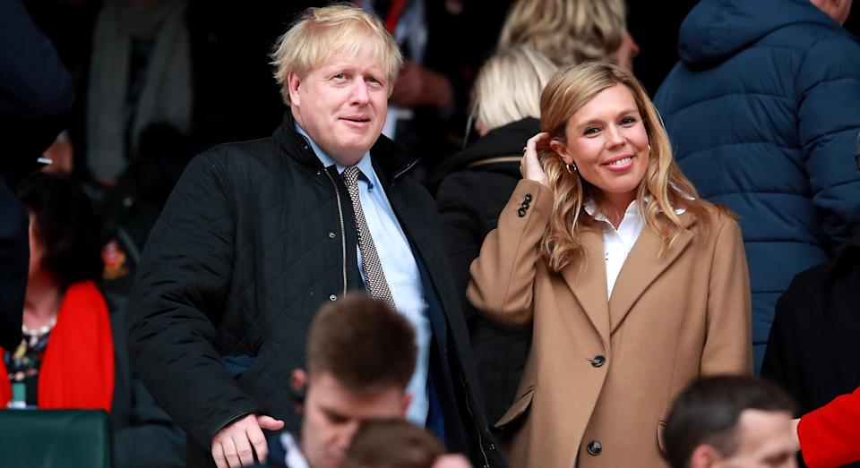 Carrie Symonds, who recently announced her pregnancy, stepped out in a stylish camel coat [Image: PA]