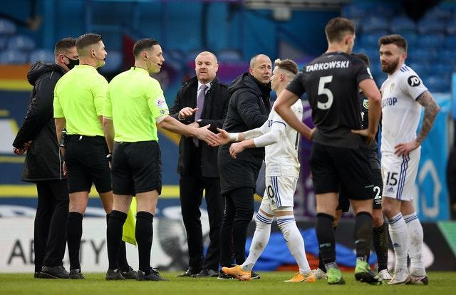 Burnley manager Sean Dyche speaks to referee Robert Jones at the final whistle at Leeds