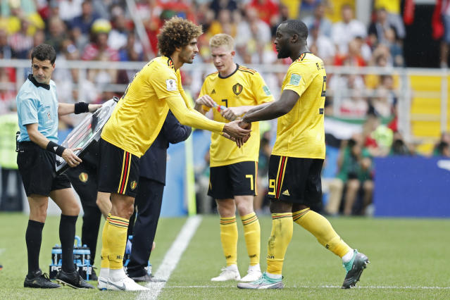 Belgium's Romelu Lukaku, right, leaves the pitch as being substituted for teammate Marouane Fellaini during the group G match between Belgium and Tunisia at the 2018 soccer World Cup in the Spartak Stadium in Moscow, Russia, Saturday, June 23, 2018. (AP Photo/Antonio Calanni)