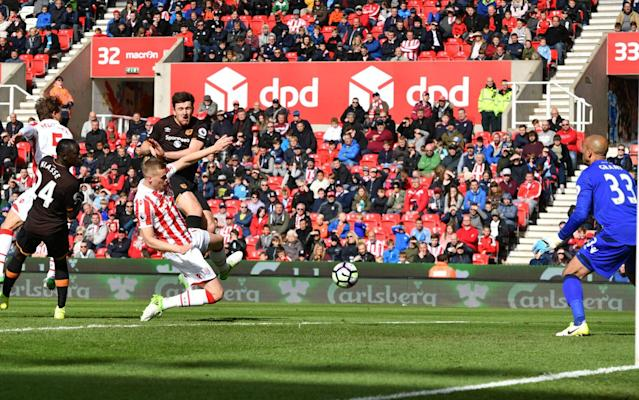 <span>Harry Maguire capitalises on the chaos to equalise for Hull</span> <span>Credit: Reuters / Anthony Devlin </span>