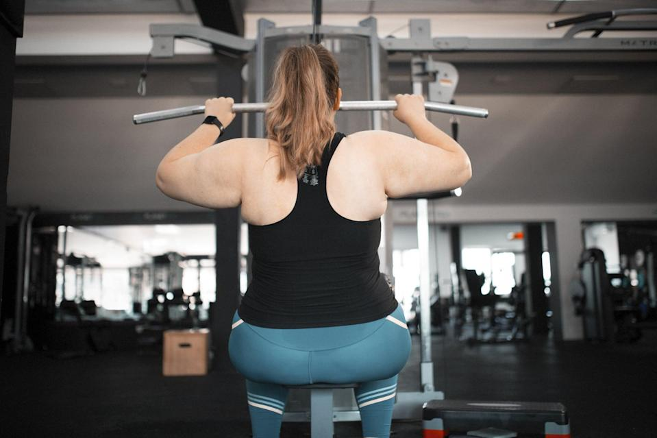 Motivated overweight women at gym