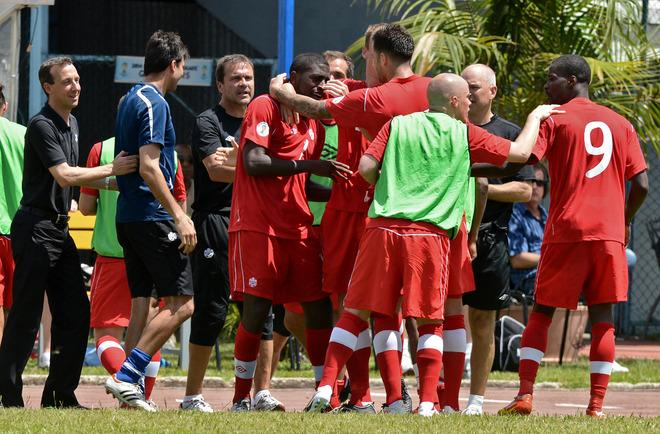 Canadian footballers celebrate the goal of Olivier Occean against Cuba during their FIFA World Cup Brazil 2014 CONCACAF qualifier match at the Pedro Marrero stadium in Havana on June 8, 2012. Canada won 1-0.      AFP PHOTO/ADALBERTO ROQUEADALBERTO ROQUE/AFP/GettyImages