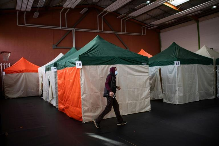 Coronavirus has made it more difficult for homeless shelters, with this one in the French city of Nantes using tents