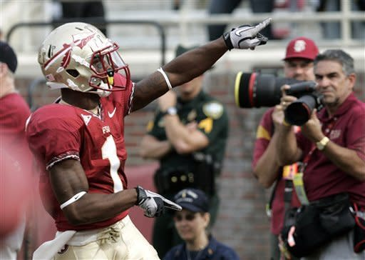 Florida State's Kelvin Benjamin celebrates his punt return for a touchdown against Duke in the first quarter of an NCAA college football game on Saturday, Oct. 27, 2012, in Tallahassee, Fla. Florida State won the game 48-7. (AP Photo/Steve Cannon)