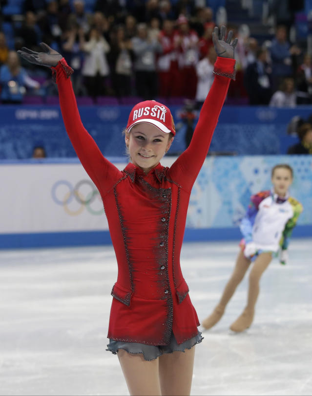 Julia Lipnitskaia of Russia leaves the ice after competing in the women's team free skate figure skating competition at the Iceberg Skating Palace during the 2014 Winter Olympics, Sunday, Feb. 9, 2014, in Sochi, Russia. (AP Photo/Darron Cummings, Pool)