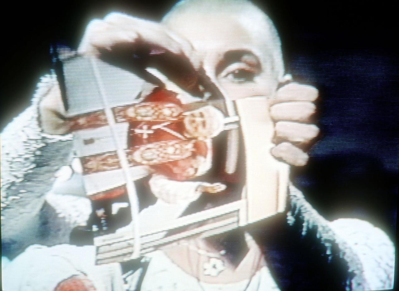 <p>In a defining moment of her career, and possibly <em>SNL</em>'s most famous controversial moment, Sinéad O'Connor concluded her 1992 performance by ripping a photo of Pope John Paul II in half. </p>
