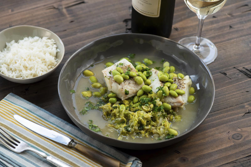 This 2018 photo provided by Katie Workman shows a dish of cod, cabbage and edamame taken in New York. Cabbage, that taken-for-granted vegetable, that sturdy, dense staple of many a poor, ancestral homeland, is finally getting respect. (Cheyenne Cohen/Katie Workman via AP)