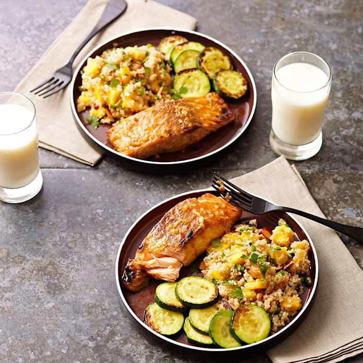 <p>In this 30-minute dinner recipe, grilled, honey mustard-coated salmon is served with a tasty grain salad made with quinoa, mango, jalapeño and almonds.</p>