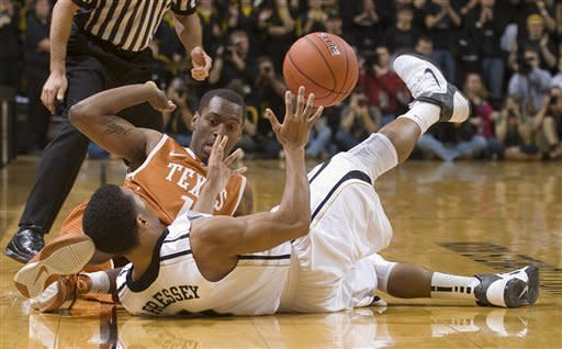 Missouri's Phil Pressey, bottom, and Texas' Sheldon McClellan, top, battle for a loose ball before it goes out of bounds during the first half of an NCAA college basketball game Saturday, Jan. 14, 2012, in Columbia, Mo. (AP Photo/L.G. Patterson)
