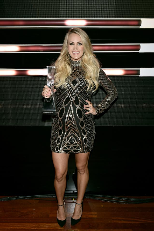 """<p>Underwood took the stage in a long-sleeved mini to perform her latest single, """"Cry Pretty."""" </p>"""