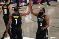 Brooklyn Nets guard James Harden (13) high-fives forward Kevin Durant during the second half of an NBA basketball game against the Chicago Bulls on Saturday, May 15, 2021, in New York. The Nets won 105-91. (AP Photo/Adam Hunger)
