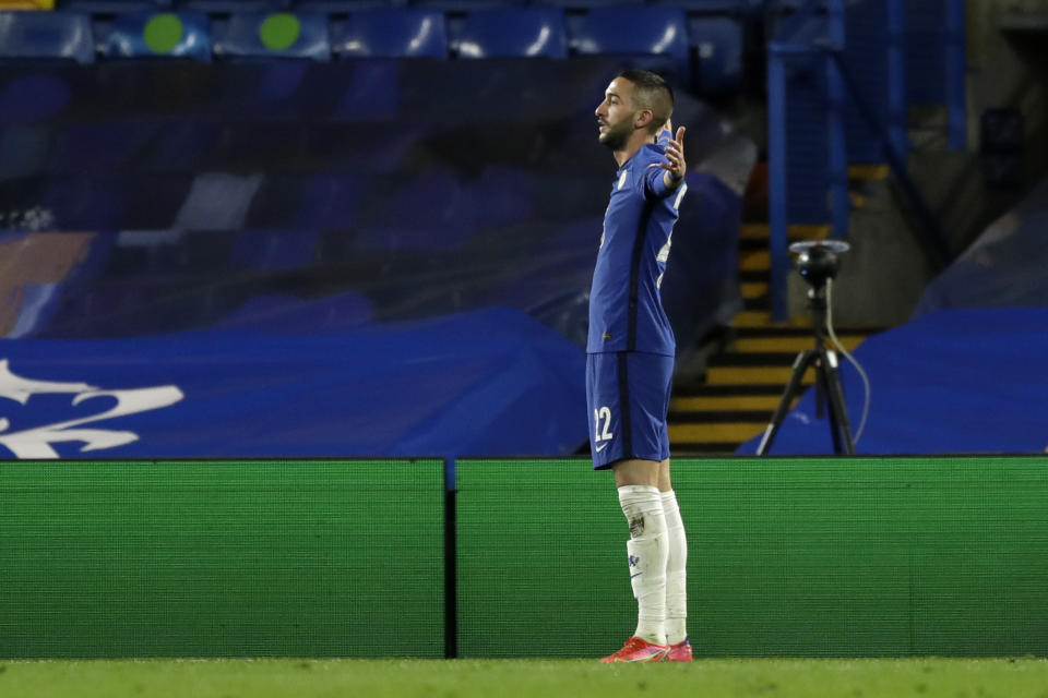 Chelsea's Hakim Ziyech celebrates after scoring his side's opening goal during the Champions League, round of 16, second leg soccer match between Chelsea and Atletico Madrid at the Stamford Bridge stadium, London, Wednesday, March 17, 2021. (AP Photo/Matt Dunham)