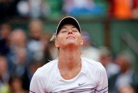 Maria Sharapova of Russia celebrates after beating Samantha Stosur of Australia during their women's singles match at the French Open tennis tournament at the Roland Garros stadium in Paris