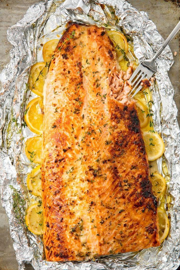 "<p>Simple is delicious. </p><p>Get the recipe from <a href=""https://www.delish.com/cooking/recipe-ideas/recipes/a55315/best-baked-salmon-recipe/"" rel=""nofollow noopener"" target=""_blank"" data-ylk=""slk:Delish."" class=""link rapid-noclick-resp"">Delish. </a></p>"