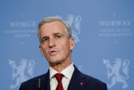 Norway's newly appointed Prime Minister Jonas Gahr Stoere holds a press conference at the Prime Minister's office, in Oslo, Thursday, Oct. 14, 2021. Norwegian authorities say the bow-and-arrow rampage by a man who killed five people in a small town appeared to be a terrorist act. (Hakon Mosvold Larsen/NTB via AP)