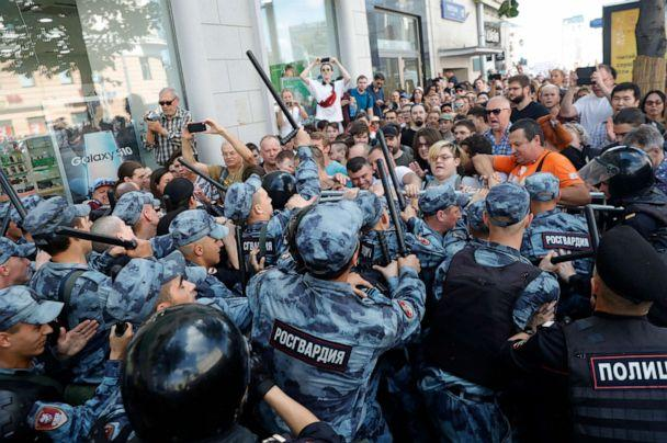 PHOTO: Protesters clash with police during an unsanctioned rally in the center of Moscow, Russia, Saturday, July 27, 2019. (Pavel Golovkin/AP)