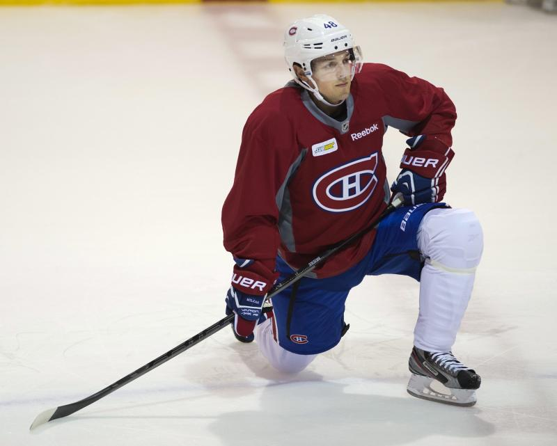 Montreal Canadiens forward Danny Briere stretches during the team's NHL hockey training camp, Thursday, Sept. 12, 2013 in Brossard, Quebec