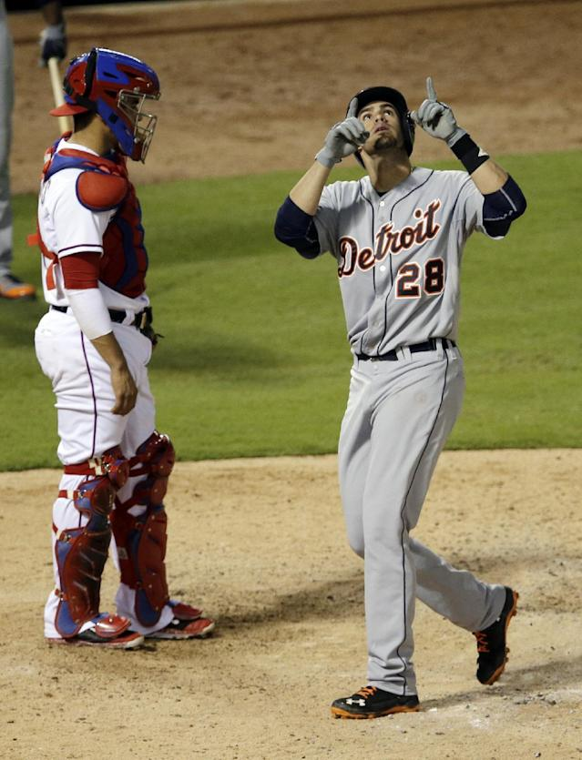 Texas Rangers' Robinson Chirinos stands by the plate as Detroit Tigers' J.D. Martinez (28) points skyward after hitting a solo home run off of Rangers relief pitcher Shawn Tolleson in the fifth inning of a baseball game, Wednesday, June 25, 2014, in Arlington, Texas. (AP Photo/Tony Gutierrez)