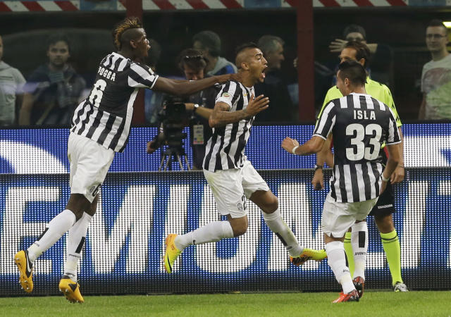 Juventus midfielder Arturo Vidal, of Chile, center, jumps in celebration after scoring while teammates Juventus midfielder Paul Pogba, of France, left, and Juventus midfielder Mauricio Isla, of Chile, reach out to congratulate him, during a Serie A soccer match between Inter Milan and Juventus, at the San Siro stadium in Milan, Italy, Saturday, Sept. 14, 2013. (AP Photo/Luca Bruno)