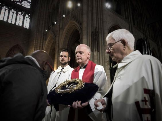 A priest held the Crown of Thorns as the relic was presented to worshippers in 2017 (Getty)
