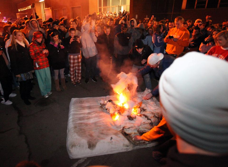 In a Jan. 12, 2010, photograph, students burn a mattress outside the football complex after Lane Kiffin announced his resignation as coach of the University of Tennessee football team. Kiffin took the coaching job at Southern California  after just one season at Tennessee. (Adam Brimer/News Sentinel)