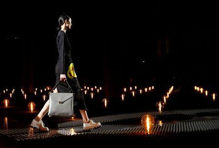 A model presents a creation by Prada during the Milan Fashion Week in Milan, Italy February 21, 2019. REUTERS/Alessandro Garofalo