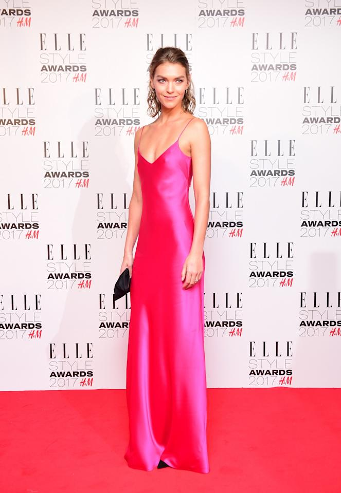 <p>Arizona stunned in a hot pink gown by Galvan London. <i>[Photo: PA]</i> </p>