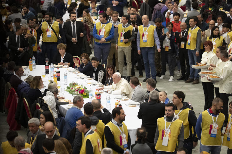 Pope Francis sits at a table during a lunch, in the Paul VI Hall at the Vatican, Sunday, Nov. 17, 2019. Pope Francis is offering several hundred poor people, homeless, migrants, unemployed, a lunch on Sunday as he celebrates the World Day of the Poor with a concrete gesture of charity in the spirit of his namesake, St. Francis of Assisi. (AP Photo/Alessandra Tarantino)