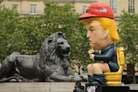 A picture shows a protest sculpture depicting US President Donald Trump on a toilet using a smartphone as protesters against the US president's State Visit gather in Trafalgar Square in central London on June 4, 2019, on the second day of Trump's three-day State Visit to the UK. (Photo by ISABEL INFANTES/AFP)