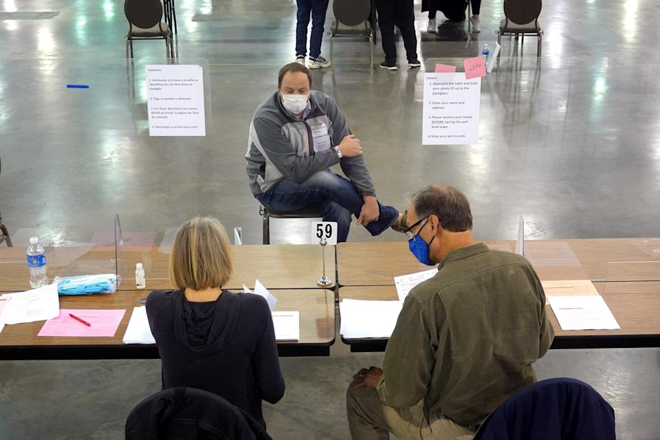 An election observer watches Wisconsin officials perform a recount of votes. (Getty Images)