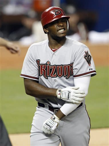 Arizona Diamondbacks' Justin Upton holds his arm after being hit by a pitch by Miami Marlins starter Carlos Zambrano in the first inning during a baseball game in Miami, Friday, April 27, 2012. (AP Photo/Lynne Sladky)