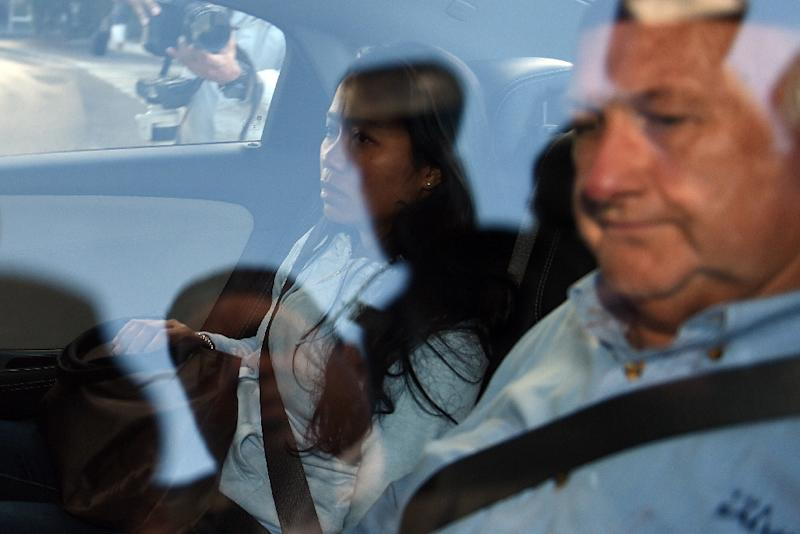 Febyanti Herewila (L), widow of executed Australian drug convict Andrew Chan, leaves Sydney International Airport on May 2, 2015 following the arrival of Chan's remains (AFP Photo/Saeed Khan)