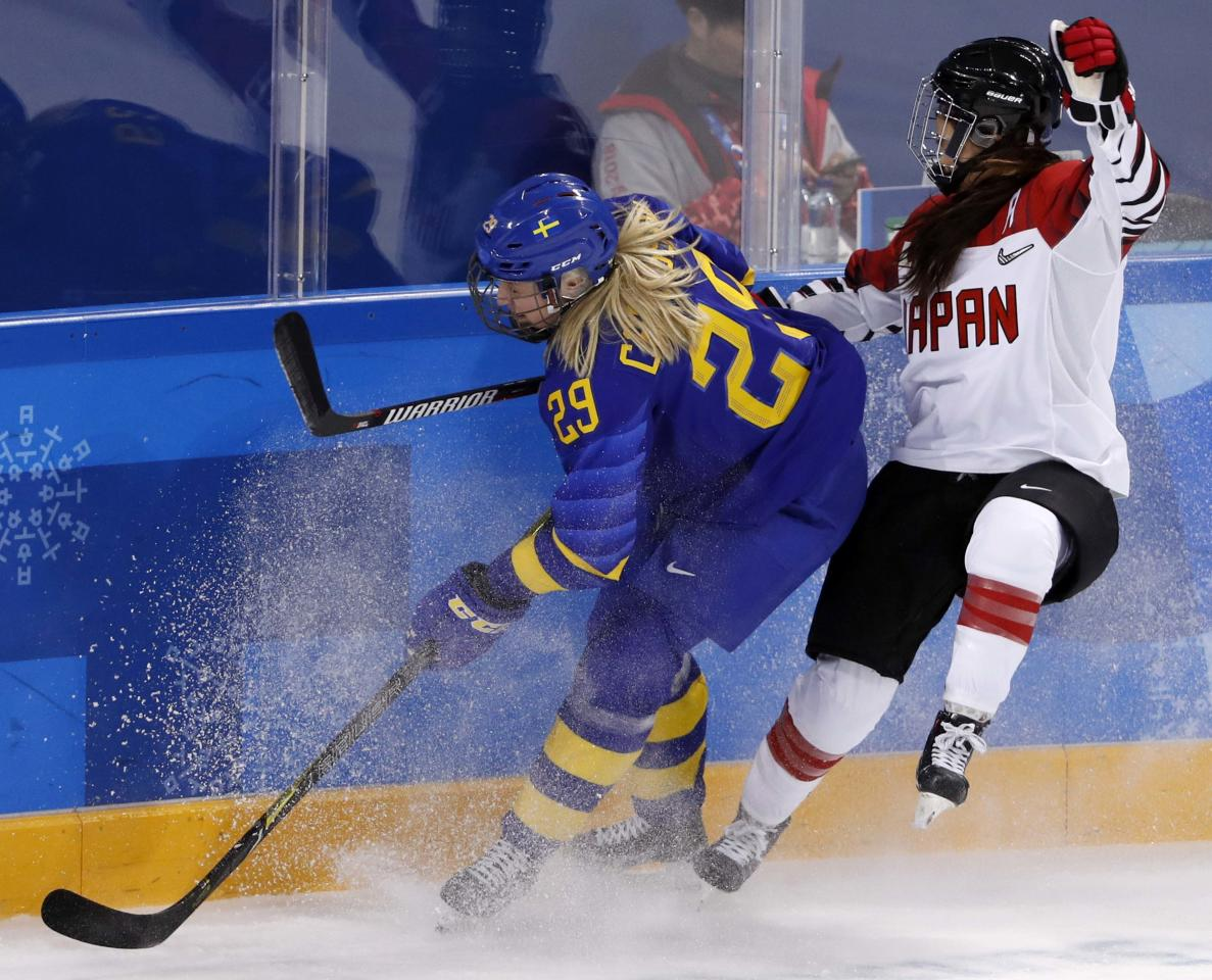 Ice Hockey - Pyeongchang 2018 Winter Olympics - Women's Classification Match - Sweden v Japan - Kwandong Hockey Centre, Gangneung, South Korea - February 18, 2018 - Olivia Carlsson of Sweden and Sena Suzuki of Japan (R) in action. REUTERS/Kim Kyung-Hoon