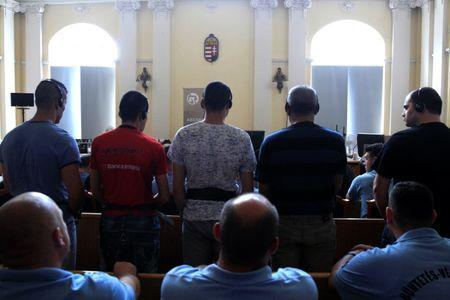 Defendants stand in the court room, ahead of the trial in which they are charged with causing the death of 71 migrants who suffocated in a lorry found beside an Austrian motorway in 2015, in Kecskemet, Hungary June 21, 2017. REUTERS/Bernadett Szabo