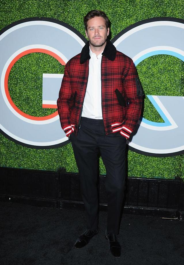 <p>Hammer wore a red plaid bomber jacket by Tommy Hilfiger to keep warm during the GQ Men of the Year party. (Photo: Getty Images) </p>