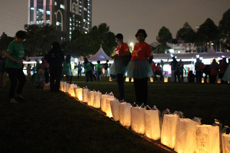 The luminaria ceremony where participants light up lanterns and candles with heartfelt messages to lost loved ones. — Picture courtesy of the National Cancer Society of Malaysia
