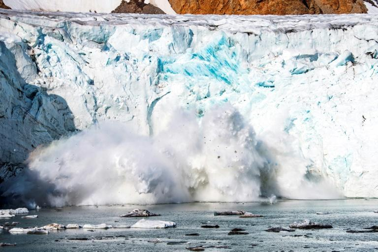 Calving - shown here at the Apusiajik glacier in Greenland - is the term for when an iceberg breaks off