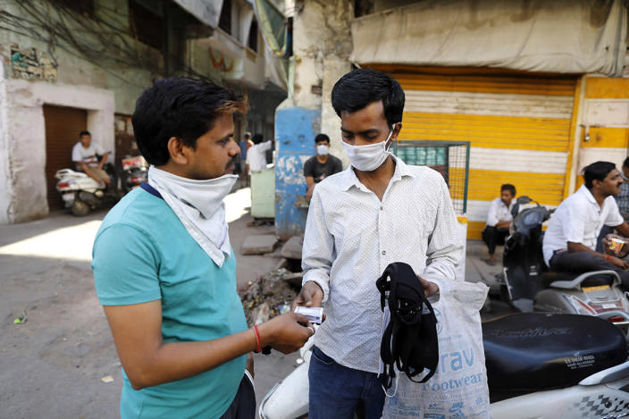 A man sells face masks during the countrywide lockdown amid concern over the spread of coronavirus in Prayagraj, India, on April 5, 2020.