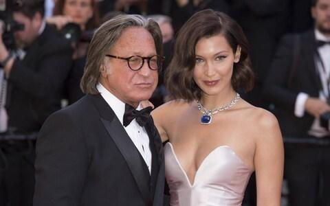 Mohamed Hadid with daughter Bella at the Cannes Film Festival - Credit: E-PRESS / BACKGRID UK