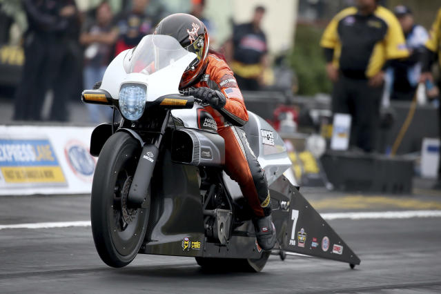 In this photo provided by the NHRA, Pro Stock Motorcycle rider Angelle Sampey's pass earns the provisional top qualifying spot Friday, Sept. 13, 2019, at the annual Mopar Express Lane NHRA Nationals in Mohnton, Pa. (Bob Szelag/NHRA via AP)