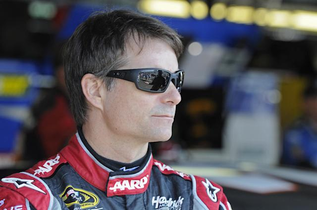 Jeff Gordon looks from the garage area before a NASCAR Sprint Cup series auto race practice at Darlington Speedway in Darlington, S.C., Friday, April 11, 2014. (AP Photo/Mike McCarn)