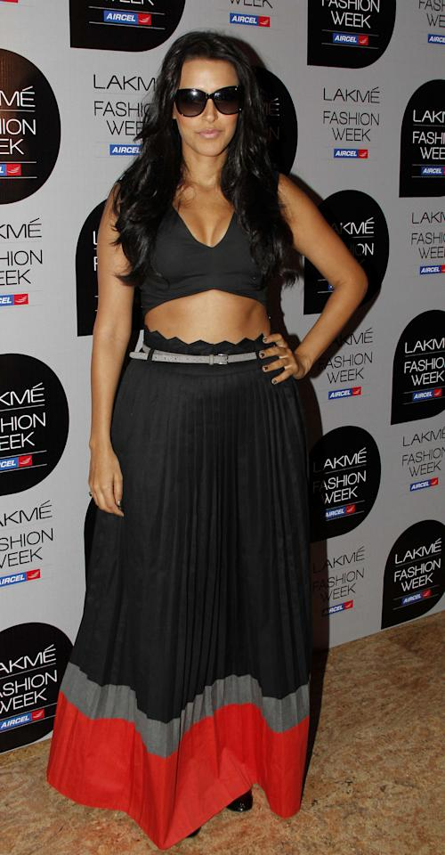 Neha Dhupia shows off her curves as she strikes a pose for the cameras.