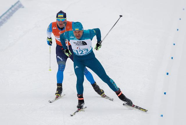 Vitaliy Luk'Yanenko of Ukraine and his guide Ivan Marchyshak compete in the Biathlon Visually Impaired Men's 15km at the Alpensia Biathlon Centre. The Paralympic Winter Games, PyeongChang, South Korea, Friday 16th March 2018. OIS/IOC/Simon Bruty/Handout via Reuters