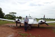 Colombian businessman and pilot Ernesto Perez, who donates flights to collect samples of the coronavirus disease (COVID-19) in villages with difficult access, poses for a photo in front of his plane at La Primavera airport, in La Primavera