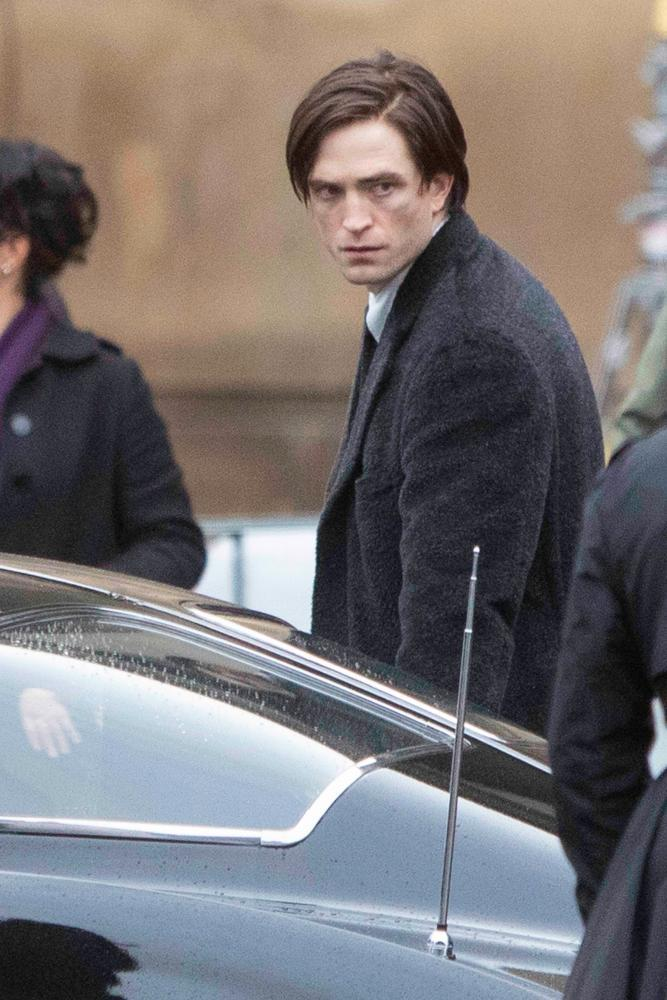 Robert Pattinson filming The Batman with side-parted curtains.