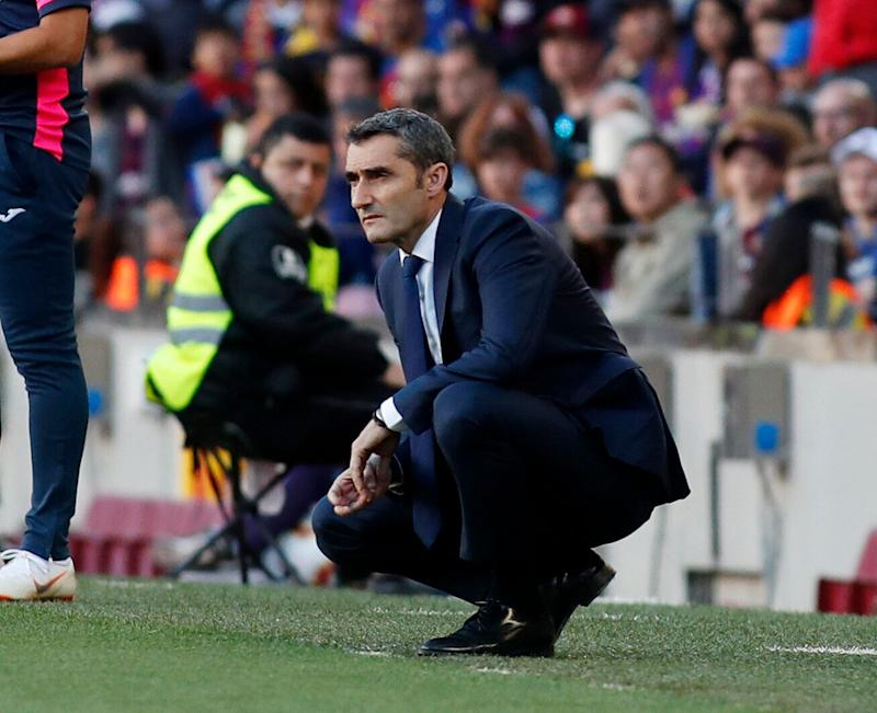 Barcelona coach Ernesto Valverde looks at the game during the Spanish La Liga soccer match between FC Barcelona and Getafe at the Camp Nou stadium in Barcelona, Spain, Sunday, May 12, 2019. (AP Photo)