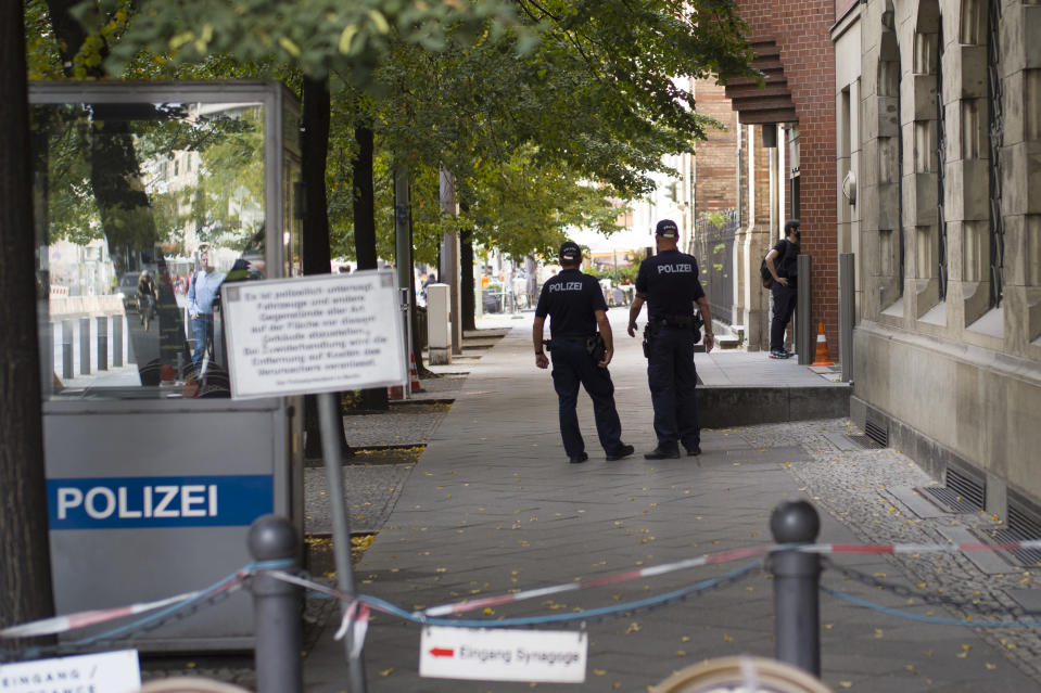 Police patrol in front of the 'New Synagogue' at Oranienburger Strasse in Berlin, Germany, Thursday, Sept. 24, 2020. Millions have be provided to enhance the security of Jewish sites, but some say it is still not enough and also doesn't tackle the question whether Jewish life can ever be normal and safe in Germany. (AP Photo/Markus Schreiber)