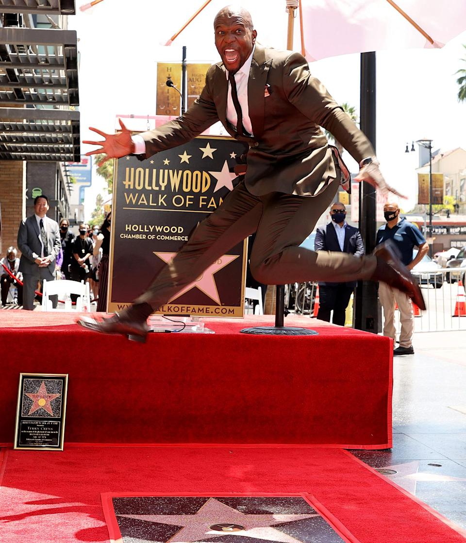 <p>Terry Crews jumps for joy while getting his own star on the Hollywood Walk of Fame in Hollywood.</p>