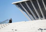 A man riding a wheelchair inspects at the Tokyo Aquatics Centre as the outbreak of the coronavirus disease (COVID-19) continues, in Tokyo